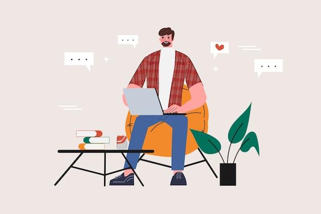 Um homem usando um laptop em casa conceito de mídia social