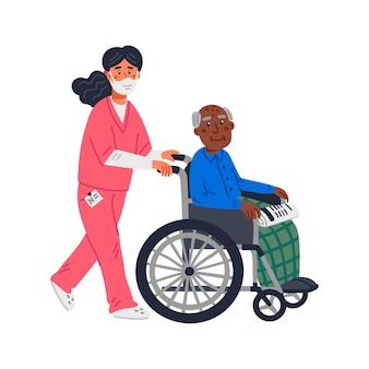 Um idoso afro-americano em uma cadeira de rodas e uma enfermeira usando uma máscara facial