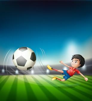Um jogador de futebol chutando a bola