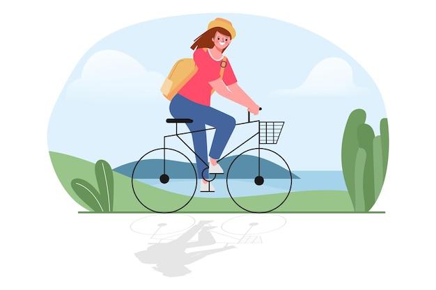 Um jovem anda de bicicleta, passeando ao ar livre.