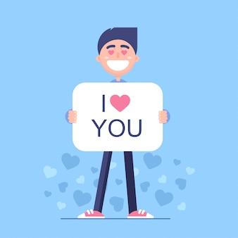 Um jovem apaixonado. o cara está segurando uma placa com uma declaração de amor.