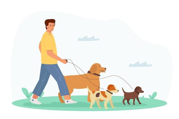 Um jovem bonito caminha com um cachorro. recreação e lazer com seus animais de estimação.