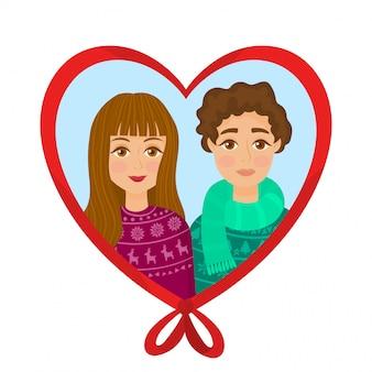 Um jovem casal apaixonado em camisolas de natal