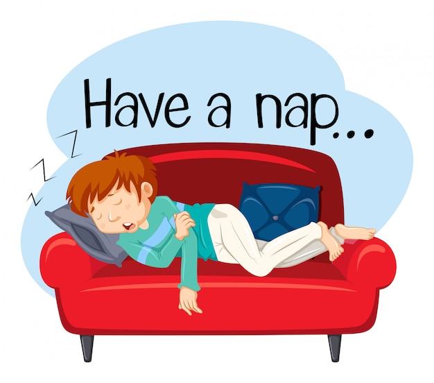 Um jovem tendo uma soneca no sofá