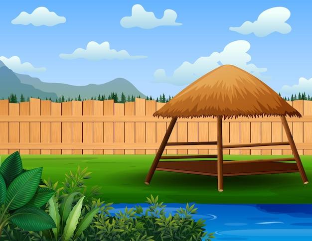 Um lindo jardim com gazebo e lagoa