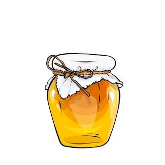 Um lindo pote de mel coberto com um guardanapo com um laço de corda.