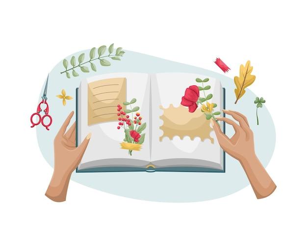 Um livro aberto com um herbário. mãos de mulher colando flores secas em um álbum