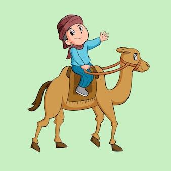 Um menino anda de camelo