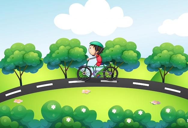 Um menino andando de bicicleta na rua