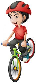 Um menino andando de bicicleta