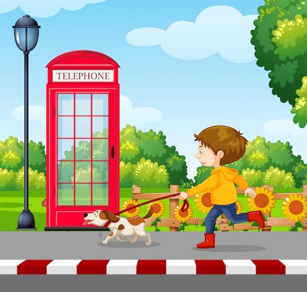 Um menino andando um cão