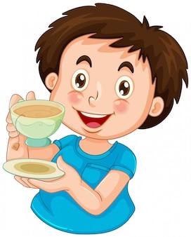 Um menino beber chá