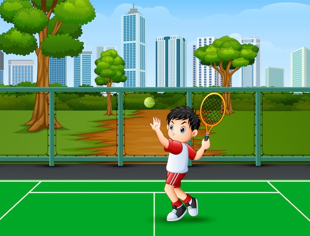 Um menino bonitinho jogando tênis