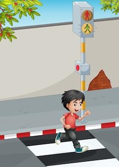 Um menino correndo ao atravessar a rua