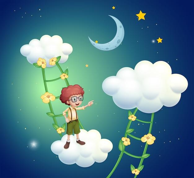Um menino de pé acima das nuvens