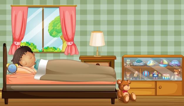 Um menino dormindo profundamente dentro de seu quarto