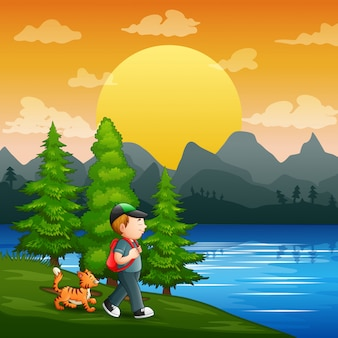 Um menino e seu animal de estimação na beira do rio