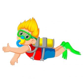 Um menino está mergulhando com os óculos de natação verdes