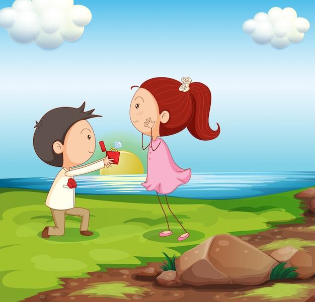 Um menino fazendo uma proposta de casamento na margem do rio