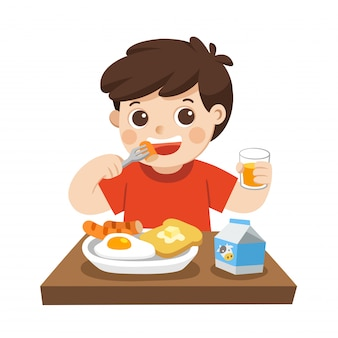 Um menino feliz em tomar café da manhã. isolado