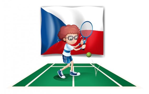 Um menino jogando tênis em frente a bandeira da república checa
