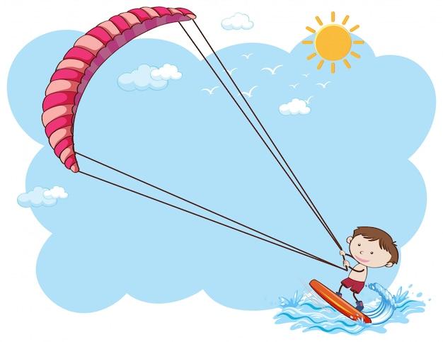 Um menino kitesurf no verão