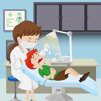 Um menino na clínica odontológica