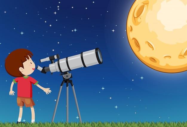Um menino observando a lua