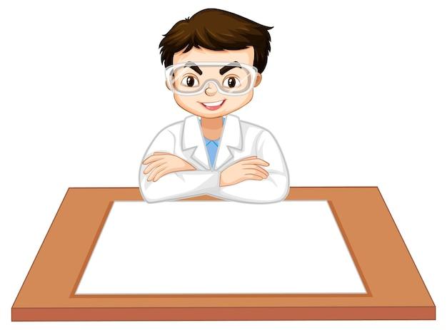 Um menino usando um vestido de cientista com um papel vazio na mesa