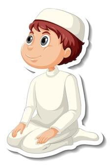 Um modelo de adesivo com um menino muçulmano em uma pose de oração, personagem de desenho animado