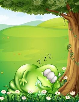 Um morro com um monstro dormindo debaixo da árvore