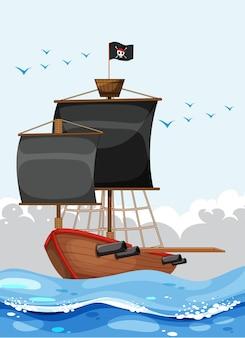 Um navio pirata com a bandeira de jolly roger no oceano