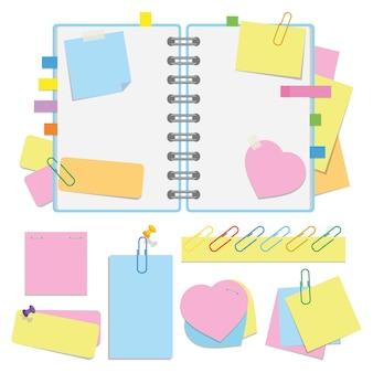 Um organizador aberto com folhas limpas em espiral e com marcadores. um conjunto de adesivos e papel para anotações.