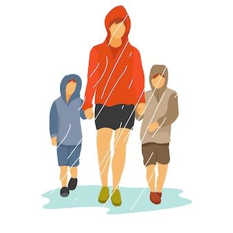 Um pai com dois filhos está andando na chuva usando uma jaqueta grossa.
