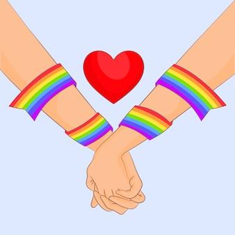 Um par de mãos com bandeira do arco-íris