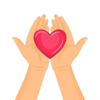 Um par de mãos segurando um coração
