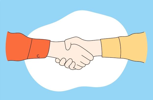 Um parceiro de negócios de mãos dadas e apertando suas mãos para negociar um contrato