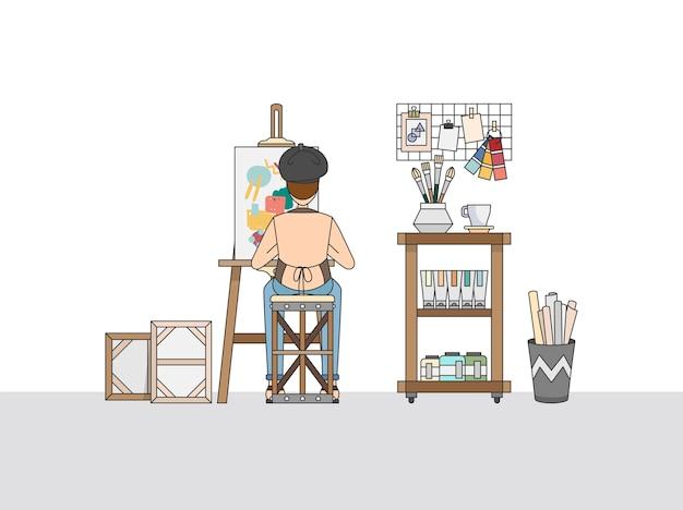 Um pintor artístico trabalhando em seu estúdio