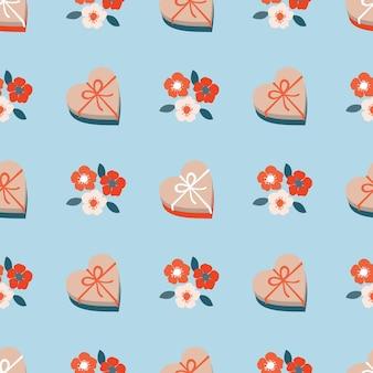 Um presente em forma de coração e flores de cerejeira sem costura padrão