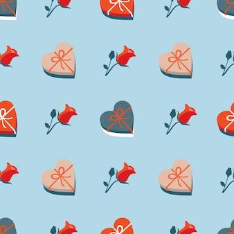 Um presente em forma de coração e um padrão de rosa vermelha