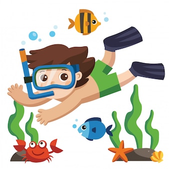 Um rapaz pequeno mergulho com peixes no fundo do oceano.