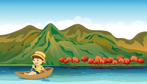 Um rio e um menino sorridente em um barco
