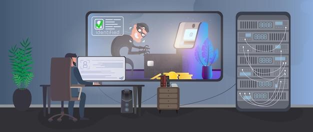 Um segurança está vigiando um ladrão em uma sala de segurança. identificação de um ladrão.
