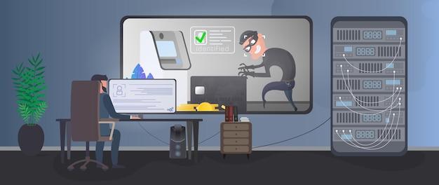 Um segurança está vigiando um ladrão em uma sala de segurança