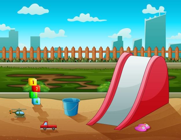 Um slide com brinquedos na cidade do parque