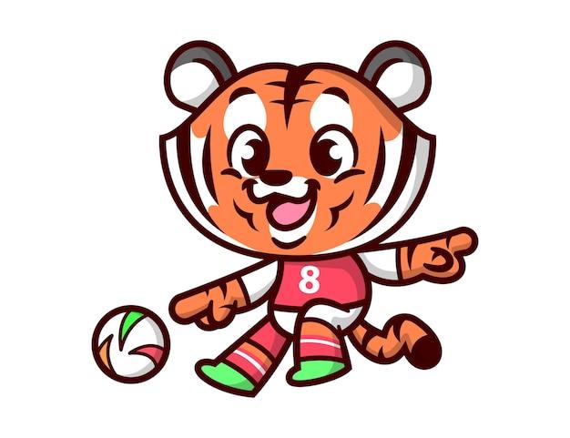 Um tigre fofo jogando futebol e vestindo uma camiseta de futebol
