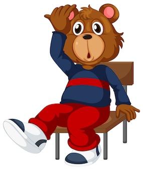 Um urso sentado em uma cadeira