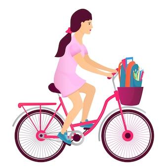 Uma adolescente anda de bicicleta e carrega uma mochila com o material do aluno. de volta ao conceito de escola.