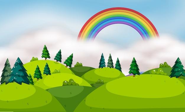 Uma bela paisagem montanhosa e arco-íris