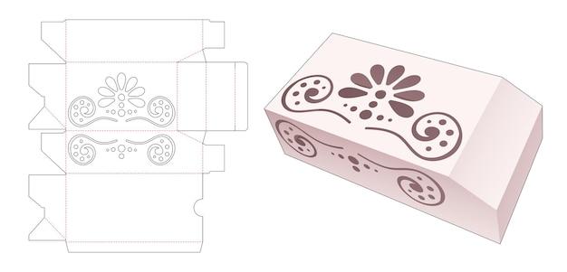 Uma caixa chanfrada com molde de mandala recortado em estêncil